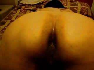 mexikanische Mama neckt von der Rückseite.